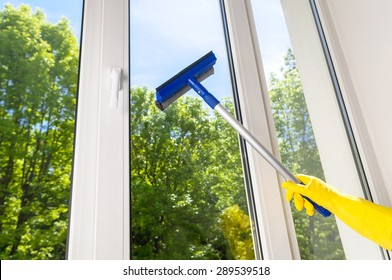 cleaning open plastic vinyl window on a background blue sky