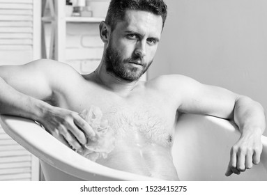Cleaning parts body. Hygiene concept. Man muscular torso sit in bathtub. Skin care. Hygienic procedure concept. Total relaxation. Personal hygiene. Take care hygiene. Nervous system benefit bathing.