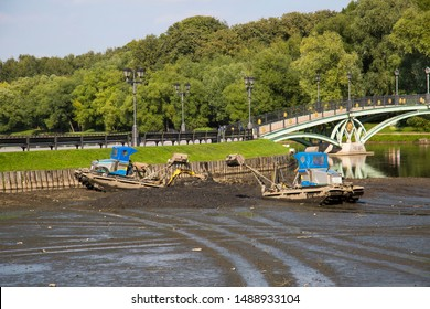 Cleaning of the pond from silt with special equipment. Landscaping of the city.