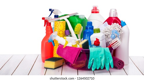 Cleaning products in basket on the wooden table