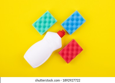 cleaning products display knolling on a yellow background, top view. the concept of cleaning and cleanliness