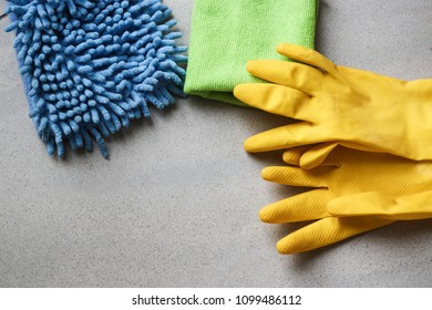 Cleaning products. Home cleaning concept. Top view. Place for typography and logo. on a marble background yellow gloves