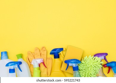 Cleaning products on a bright yellow background