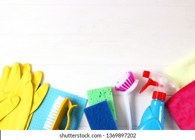 cleaning products on a colored background top view.