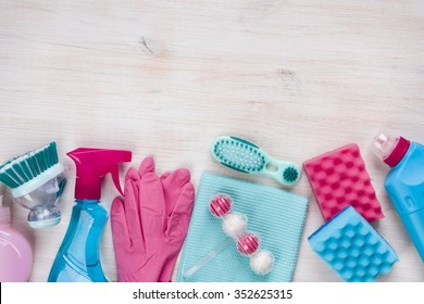Cleaning products on wooden background with copyspace at the top