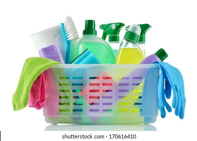Cleaning products and supplies in a basket. Cleaners, microfiber cloths, gloves  in a basket isolated on white background. Cleaning kit.