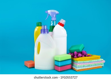 Cleaning products and supplies on a blue background.