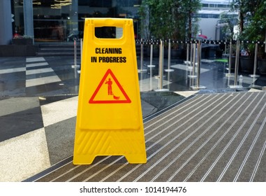 Cleaning progress caution sign, A yellow sign warning wet floor