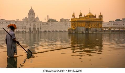 Cleaning sarovar at Golden Temple, Amritsar, Punjab, India