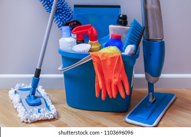 Cleaning service. Bucket with sponges, chemicals bottles and mopping stick.  Household equipment.