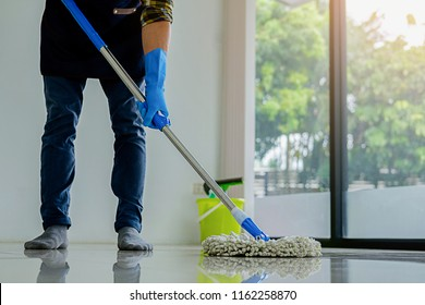 Cleaning Service concept. Cleaners employee removing dirt with equipment in office.