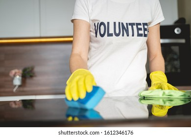 Cleaning service. Conscious woman being social worker and helping elderly people around the house
