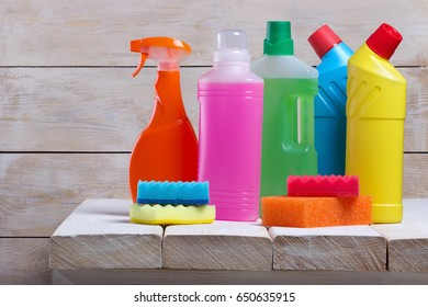Cleaning service.Cleaning product on wooden table