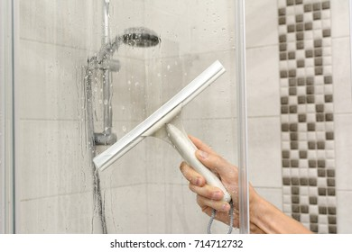 cleaning shower cubicle