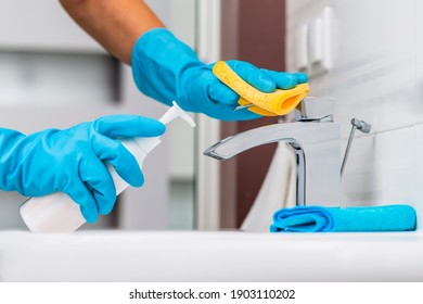 Cleaning sink and faucet with detergent.Coronavirus prevention, hygiene to stop spreading coronavirus.