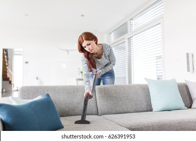 Cleaning the Sofa with Vacuum Cleaner