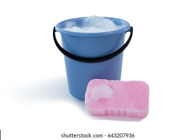 Cleaning sponge by bucket with soap sud against white background