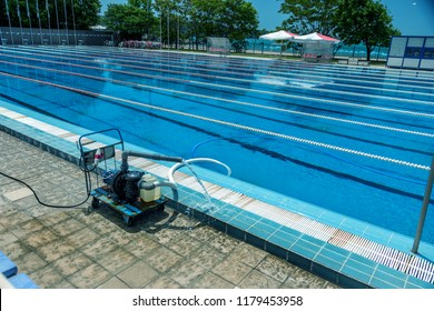 Cleaning the sports pool with a cleaning water pump. The water pump filters the water from the bottom of the pool, cleans from dirt and debris. The cleaning pump works with the pool.