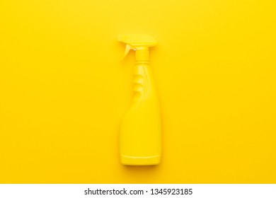 cleaning spray on the yellow background with copy space