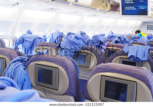 Cleaning staffs clean inside the cabin of commercial airplane.