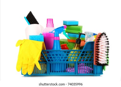 Cleaning supplies in basket on white background