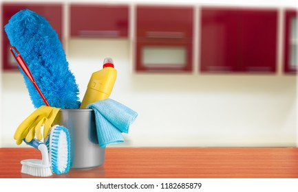 Cleaning supplies and gloves in plastic bucket