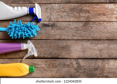 Cleaning supplies on wooden background