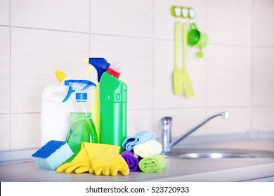 Cleaning supplies and tools on the kitchen countertop