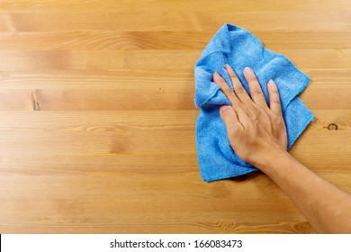 Cleaning table by hand