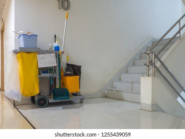 Cleaning tools cart wait for cleaner.Bucket and set of cleaning equipment in the apartment. janitor service janitorial for your place. Concept of service, worker and equipment for cleaner