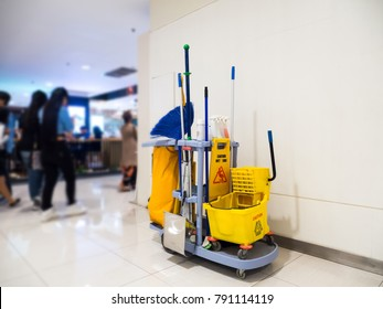 Cleaning tools cart wait for cleaning.Bucket and set of cleaning equipment in the Department store. cleaning service concept