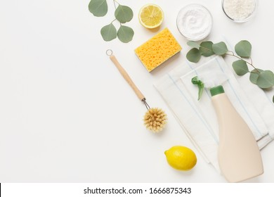 Cleaning tools layout baking soda, lemon, mustard powder on white background, copy space