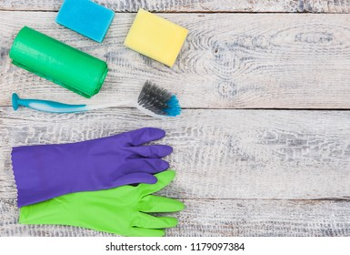 Cleaning tools lying on wood planks