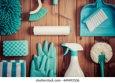 Cleaning tools placed on top of the wood table