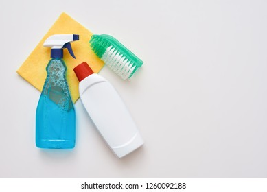 Cleaning tools. Spray bottle and orange cleaner cloth and brush isolated