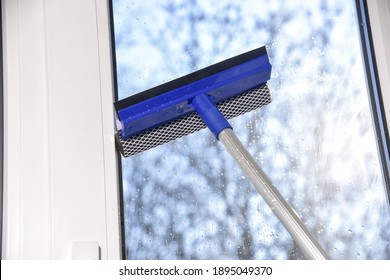 cleaning of vinyl plastic window on blue sky background