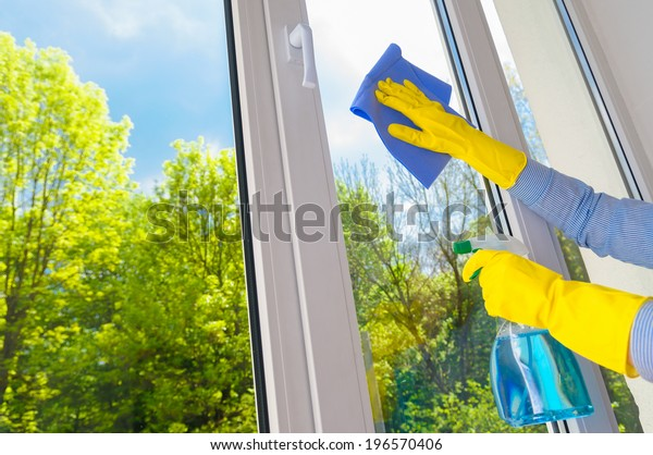 cleaning vinyl plastic window on a background blue sky