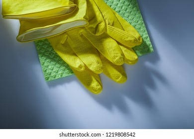 Cleaning washcloth protective gloves on white surface.