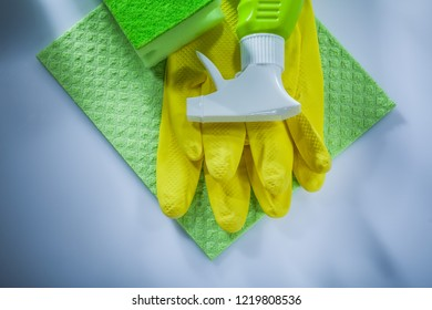 Cleaning washcloth sponge sprayer safety gloves on white background.