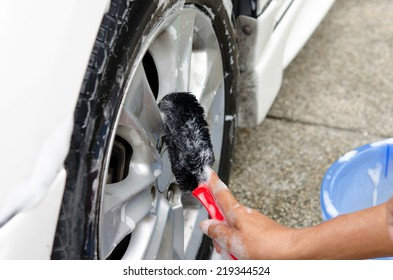 cleaning the wheel car wash with a Brush