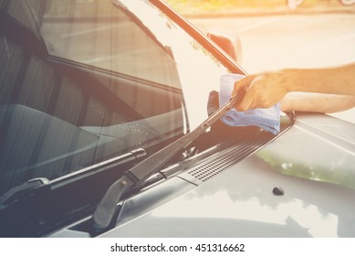 Cleaning a windshield wiper with microfiber cloth, picture vintage style