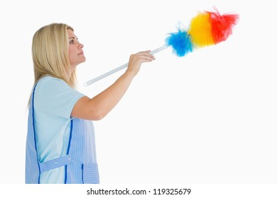 Cleaning woman using a feather duster in the white background