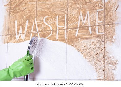 cleaning woman washes a wall in the bathroom, where it says wash me on a white background