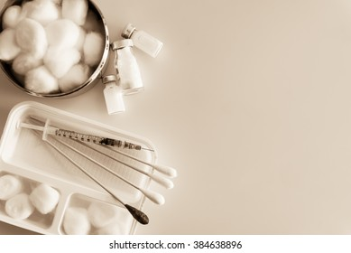 Cleaning wounds with syringes and medicine on sepia tone background