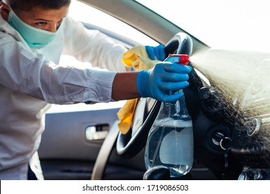 Cleansing car interior and spraying with disinfection liquid. Prevent infection of Covid-19 virus coronavirus.