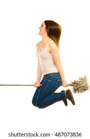 Cleanup housework concept. Funny cleaning lady young woman mopping floor, holding mop jumping flying on white background