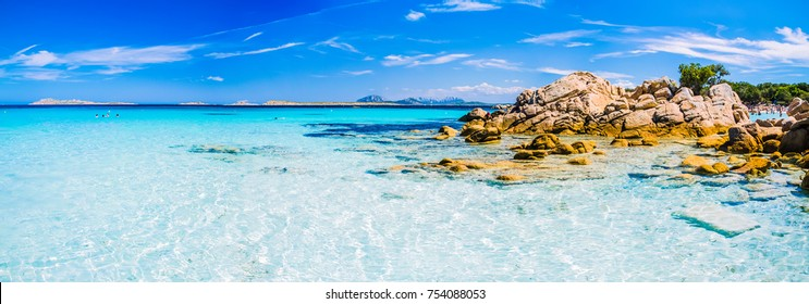Clear amazing azure coloured sea water with granite rocks in Capriccioli beach, Sardinia, Italy.