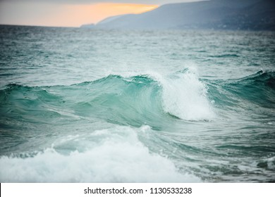 Clear aqua waves off the California Pacific Ocean coast in Malibu. perfect for surfing as a hobby or sport. easy water currents to not get pushed around in the ocean