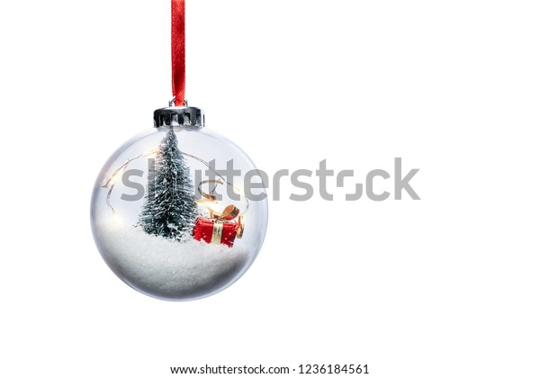 Clear Ball Ornament  with christmas tree,  small gift and christmas light inside.  Clear Ball Ornament  with Christmas decorations isolated on white background.