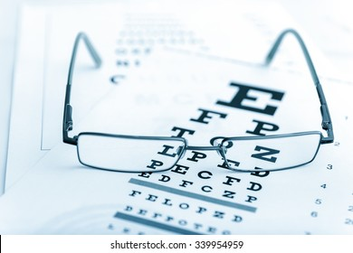 Clear Black modern glasses on a eye sight test chart..toned image